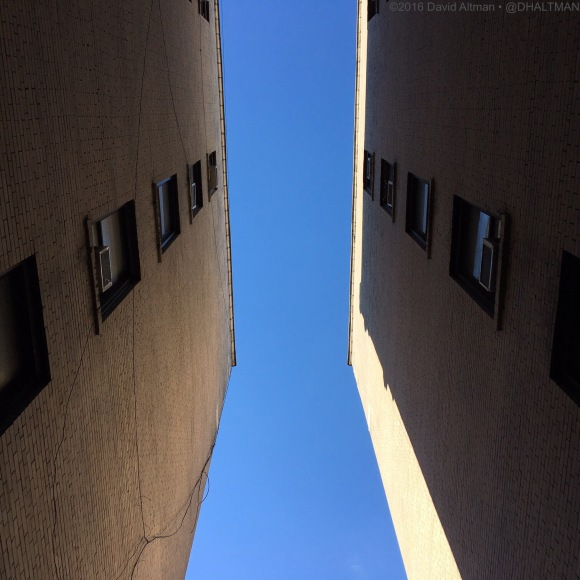 photo: blue sky between apartment building